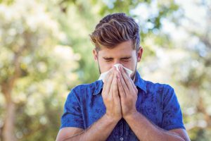 istock 482561024 300x200 Handsome hipster blowing his nose